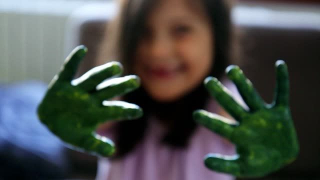 girl showing her hands covered in green paint - art and craft stock videos & royalty-free footage