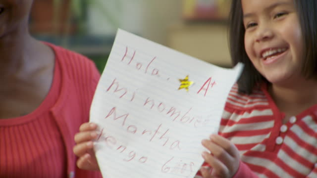 CU, ZI, Girl (6-7) showing her project to class, Richmond, Virginia, USA