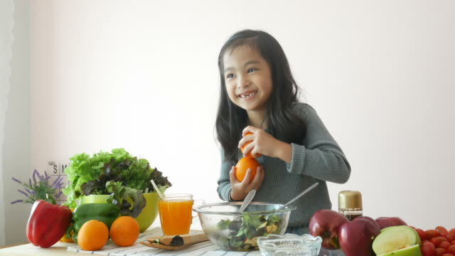girl showing how to cooking salad , play peekaboo game - peekaboo game stock videos & royalty-free footage