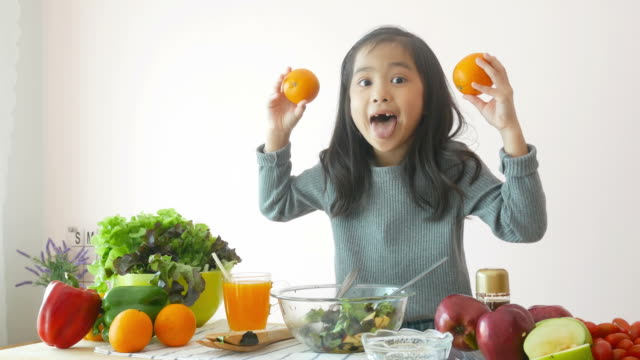 girl showing how to cooking salad , play peekaboo game - orange stock videos & royalty-free footage