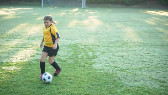 girl showing off her soccer skills, ball control - soccer uniform stock videos & royalty-free footage