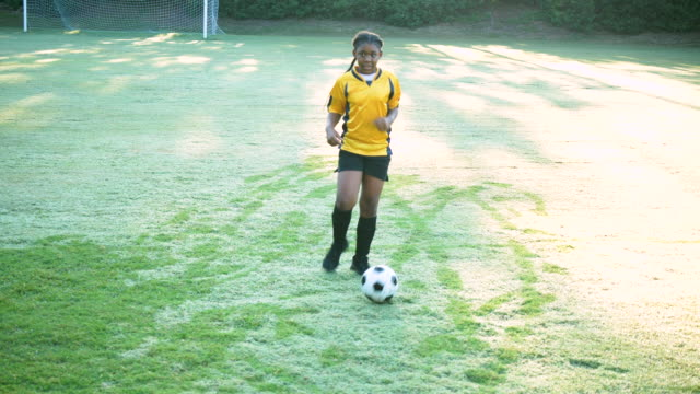 girl showing off her soccer skills, ball control - girls stock videos & royalty-free footage