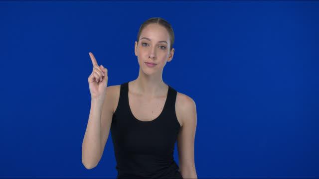vídeos y material grabado en eventos de stock de una chica muestra que un dedo advierte del fracaso. - sign