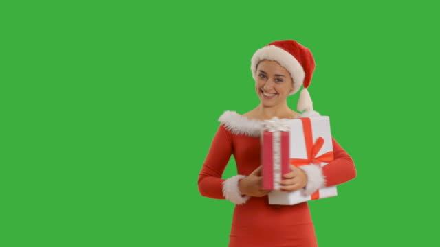 girl shows copy space in santa hat - santa hat stock videos & royalty-free footage