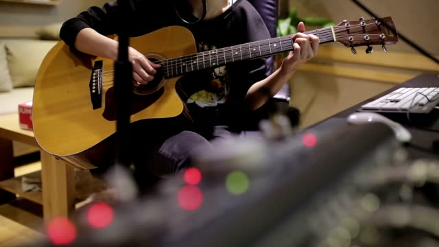 girl singing and playing guitar in recording studio - recording studio stock videos & royalty-free footage