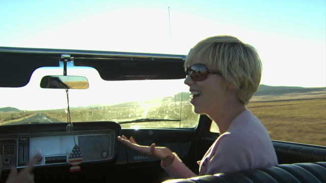 girl singing while riding in a convertible - see other clips from this shoot 1138 stock videos and b-roll footage