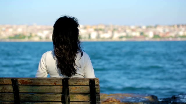 girl sitting bench near the sea - bench stock videos & royalty-free footage