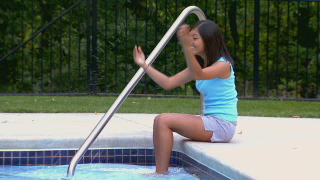 girl sitting by a pool - one teenage girl only stock videos & royalty-free footage