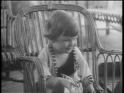 b/w 1934 portrait girl sitting in wicker chair on deck of cruise ship - wicker stock videos & royalty-free footage