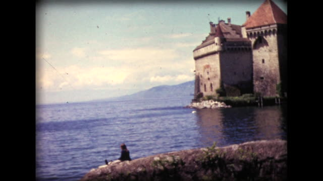 1971 girl sitting Lake Geneva shore near Chateau de Chillon