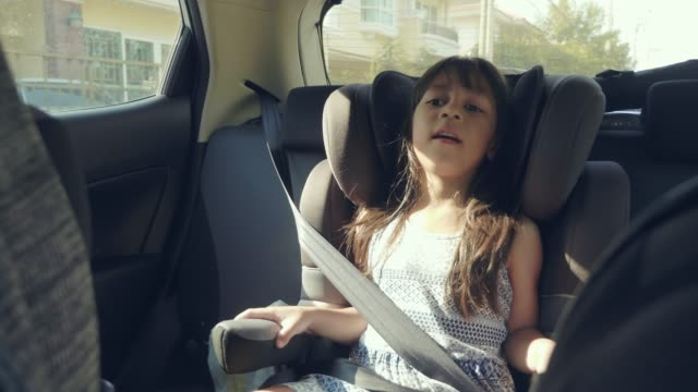 girl sitting on a car seat - comfortable stock videos & royalty-free footage