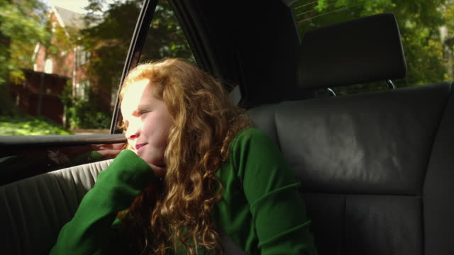 ms girl (10-11) sitting on back seat of car and enjoying ride / atlanta, georgia, usa - vehicle seat stock videos & royalty-free footage