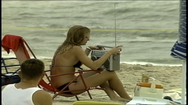 girl sitting on beach with large boombox in point pleasant nj - portable stereo stock videos & royalty-free footage