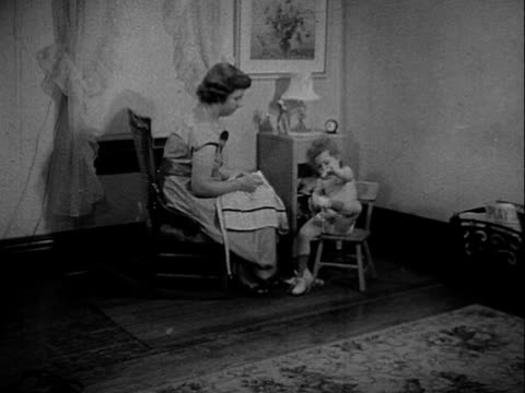 girl sitting on chair next to mother's putting on her shoe mother handing her dress child preparing to put on clothes by herself - dress shoe stock videos and b-roll footage