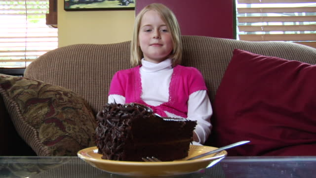 ms portrait girl sitting on couch eating chocolate cake/ vancouver, bc - see other clips from this shoot 1100 stock videos & royalty-free footage