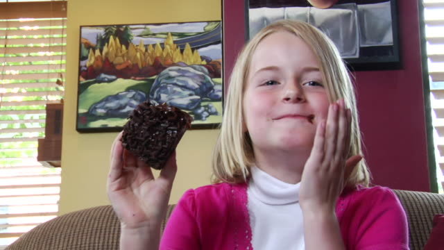 vídeos y material grabado en eventos de stock de ms girl sitting on couch/ td cu girl picking up chocolate cake/ tu ms girl taking bite of cake/ vancouver, bc - kelly mason videos
