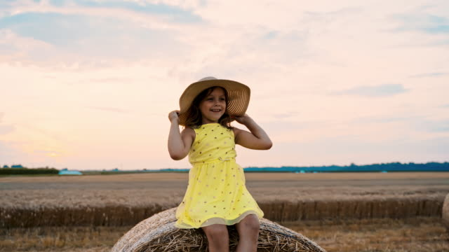ms girl sitting on hay bale - straw hat stock videos & royalty-free footage