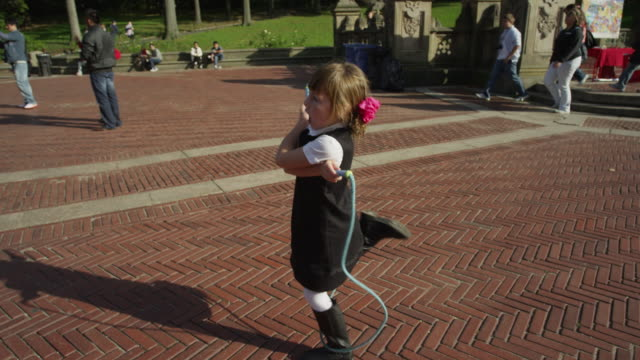 slo mo ms girl skipping on skipping rope in central park / new york city, new york state, usa - jump rope stock videos and b-roll footage