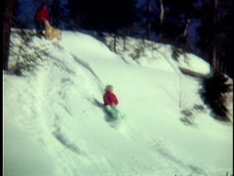 1975 ws pan girl (12-13) sledding down hill on sack, ripton, vermont, usa - blonde hair stock videos and b-roll footage