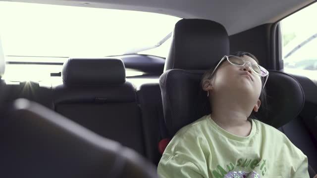 girl sleeping in running car / south korea - 人間の鼻点の映像素材/bロール