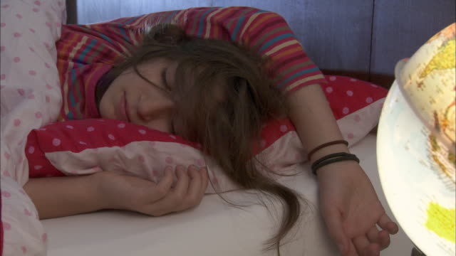 cu girl (10-11) sleeping on bed / brussels, belgium - 10 11 years stock videos and b-roll footage