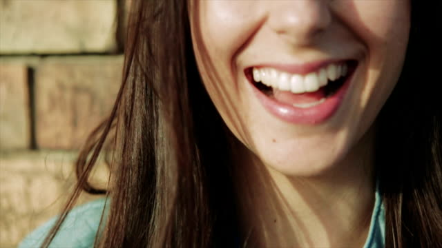 girl smiling on the wind - slow motion - teeth stock videos & royalty-free footage