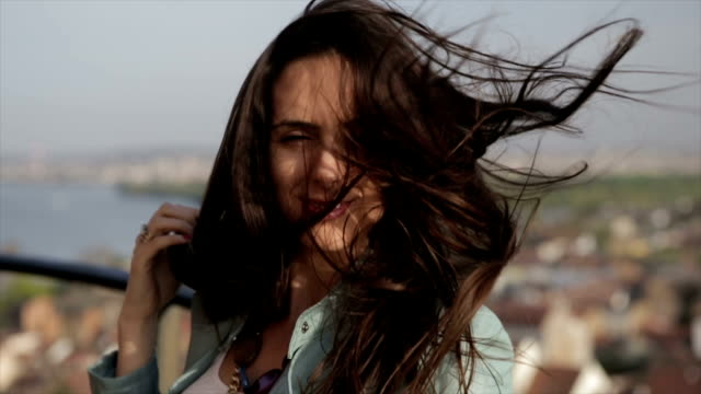 Girl smiling on the wind - slow motion