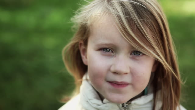 cu girl (6-7) smiling, portrait / corsept, loire-atlantique, france - 6歳から7歳点の映像素材/bロール