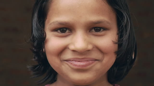 cu girl (8-9) smiling, portrait / hasanpur, mewat, haryana, india - mädchen stock-videos und b-roll-filmmaterial