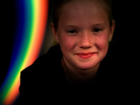girl (8-10) smiling, rainbow in background - 10 11 anni video stock e b–roll