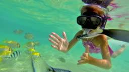Girl snorkelling underwater