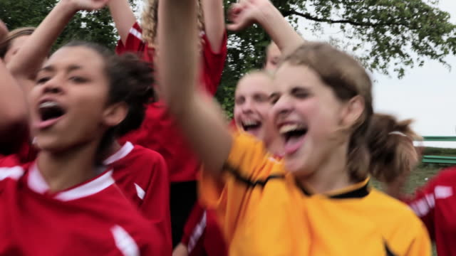 girl soccer players cheering - jubeln stock-videos und b-roll-filmmaterial