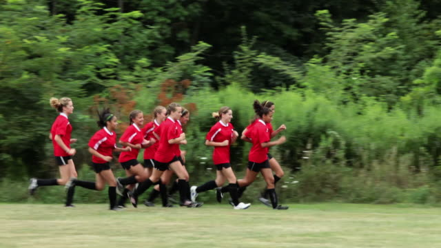 girl soccer players running, one girl trails behind - chatham new york state stock videos & royalty-free footage