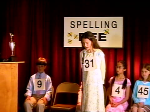 girl spelling word on stage in spelling bee / los angeles, california - 2006 stock videos and b-roll footage