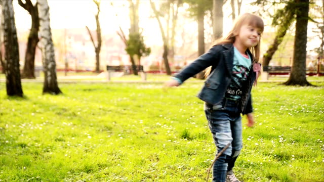 girl spinning in the park. slow motion - coat stock videos & royalty-free footage