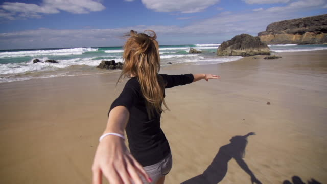 girl spinning on a sandy beach - mgost stock videos and b-roll footage