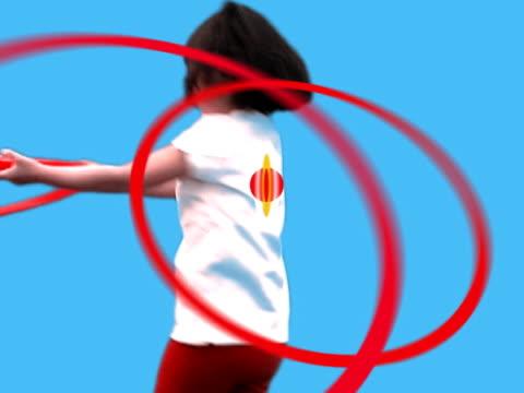vídeos y material grabado en eventos de stock de girl spinning with plastic hoop - aumento digital