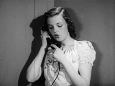 b/w 1949 girl standing in corner talking on telephone / educational - negative emotion stock videos & royalty-free footage