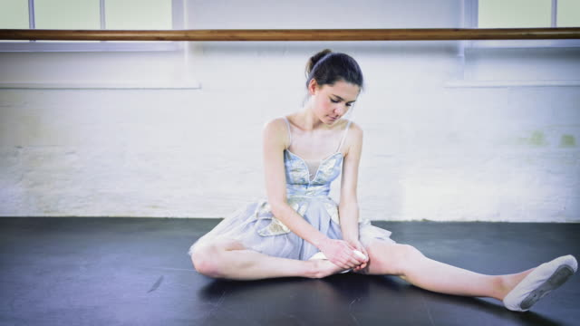 girl stretching in ballet studio - sitting on floor stock videos & royalty-free footage
