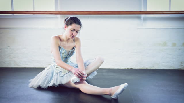 girl stretching in ballet studio - ballet shoe stock videos and b-roll footage