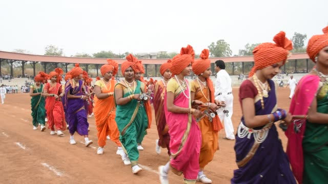 girl students perform traditional indian sport lezim. - süden stock-videos und b-roll-filmmaterial