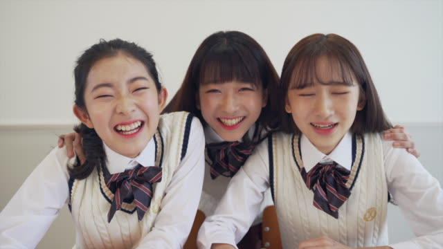 girl students studying and smiling in the classroom - east asian ethnicity stock videos & royalty-free footage