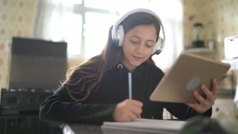 girl studying and making a video call via tablet at home - using digital tablet stock videos & royalty-free footage