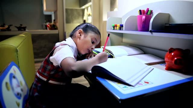 Girl studying at home, Delhi, India
