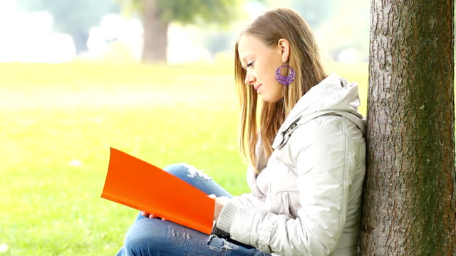 girl studying at the park. - female high school student stock videos & royalty-free footage