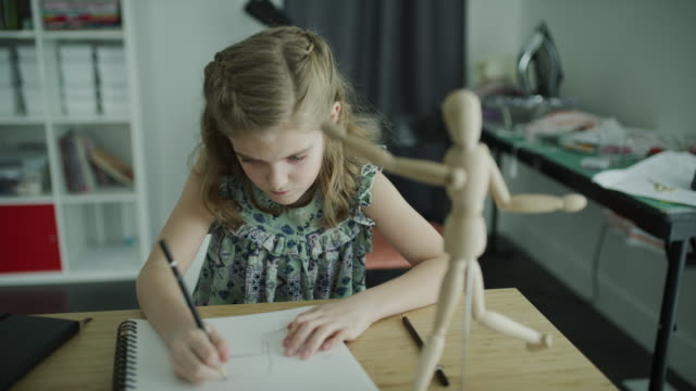girl studying human figure model and drawing on sketchpad / lehi, utah, united states - lehi stock videos & royalty-free footage