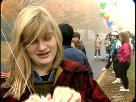 girl sucking helium out of balloon in connecticut - helium stock videos & royalty-free footage