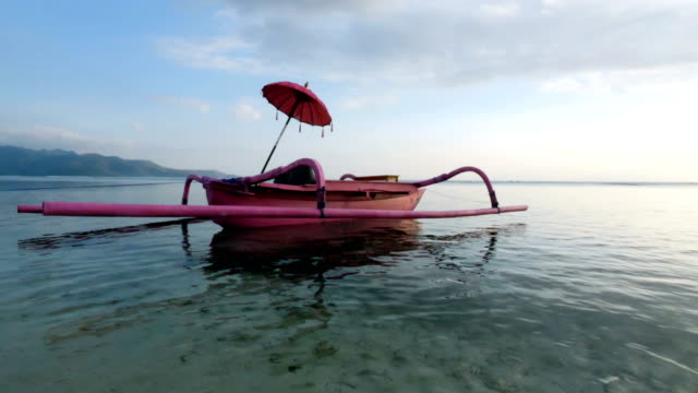 girl sunbathing on a pink boat in gili trawangan island in bali - bali stock videos & royalty-free footage