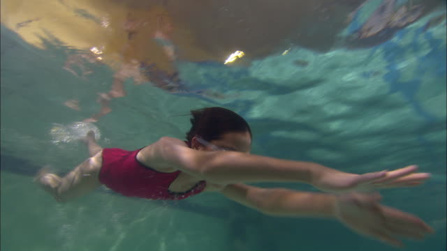 la ws pan girl swimming across pool and wearing swim goggles / riverhead, new york, usa - one piece swimsuit stock videos and b-roll footage