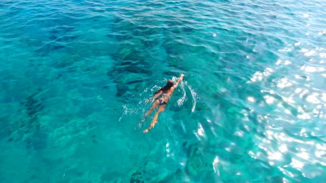 girl swimming  in transparent sea water. - bikini stock videos & royalty-free footage